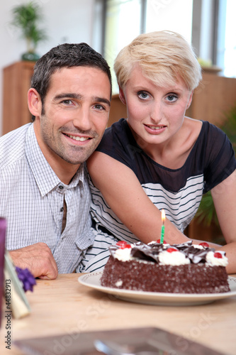Couple with birthday cake