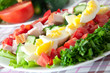 Fresh salad with chicken breast,lettuce, eggs and tomatoes