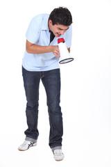 Studio shot of man shouting into a megaphone