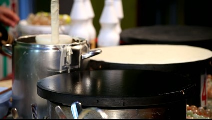 Young Adult Woman Makes Pancake