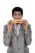 Businessman eating a yummy sandwich