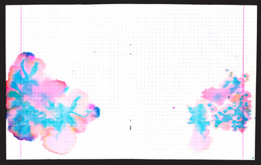 Colorful ink blots on copybook