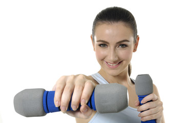 Portrait of a pretty girl exercising with weights