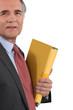 senior businessman holding files isolated on white