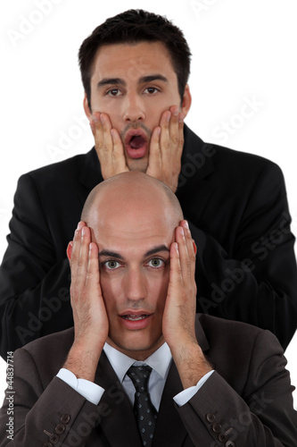 Shocked business duo