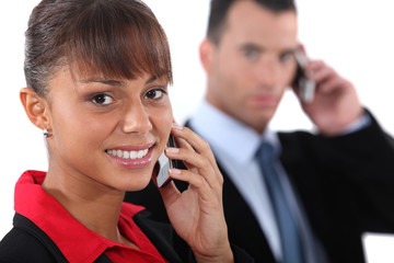 Businesspeople using cellphones