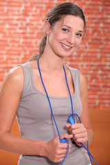 Young woman with a skipping rope