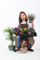 Little girl pretending to be florist