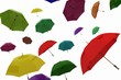 flying of multicoloured umbrellas on a white