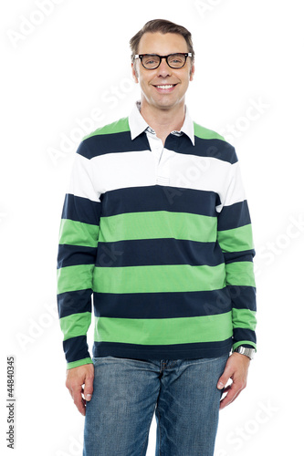 Cheerful guy portrayed in colorful attire