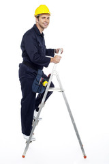 Industrial employee stepping up the ladder