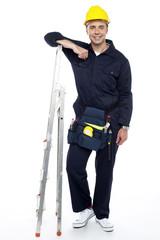 Industrial engineer resting his hands on stepladder