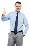 Picture of a male executive showing thumbs up