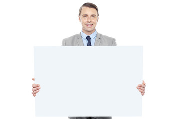 Business representative holding white billboard