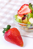 Strawberry and fruit salad in white plate