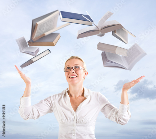 Woman with flying books