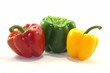 Red, green and yellow bell peppers on white background