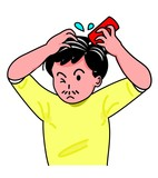 育毛剤をつける男性