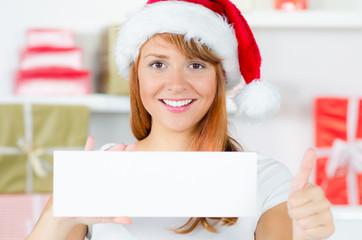 daumen hoch mit weihnachtsmütze