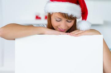 werbeschild mit weihnachtsfrau