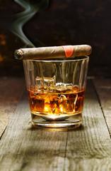 Cuban cigar and glass of brandy