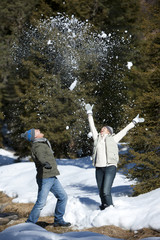 Couple playing in snow together