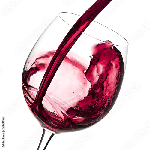 Poster Oceanië Red wine pouring to wine glass
