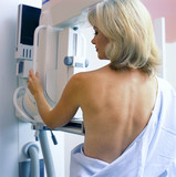Woman receiving mammogram in clinic