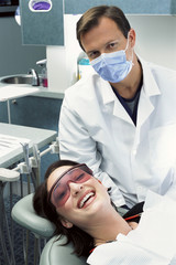 Portrait of dentist and smiling patient