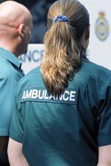 Paramedics standing outside ambulance