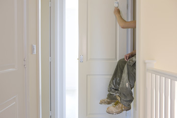 Painter painting door white