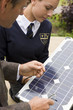 Teacher and female student with solar panel