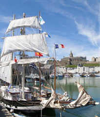 Old-fashioned sailing ship in harbor of Granville, France