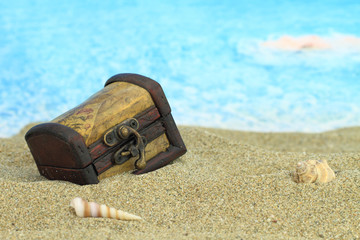Closed treasure chest on a beach