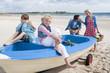 Happy family in boat on beach