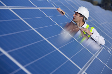 Engineer inspecting solar panels