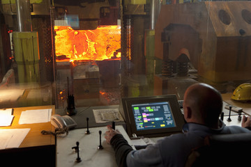 Man working in steelworks control room