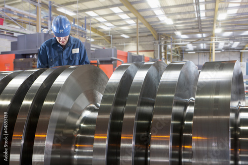Engineer working on metal machinery