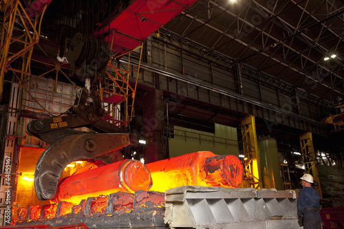Engineer watching molten forged steel in furnace