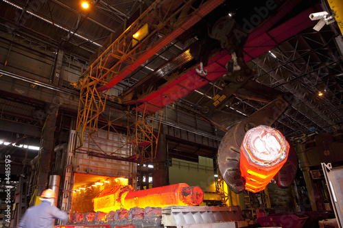 Molten forged steel being removed from furnace with crane
