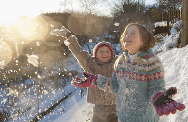 Boy and girl throwing snow