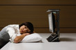 Businesswoman sleeping on pillow at desk