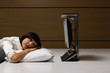 Businesswoman laying on pillow and looking at computer at desk