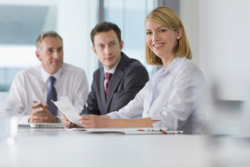 Portrait of smiling business people in meeting
