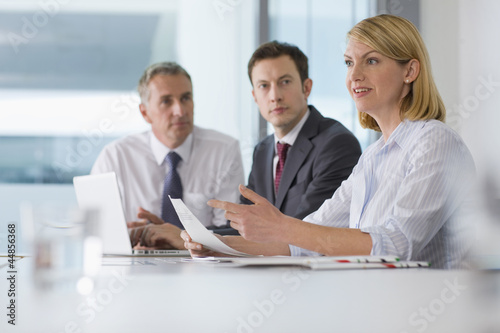 Confident businesswoman talking in meeting