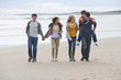 Teenage friends walking on beach