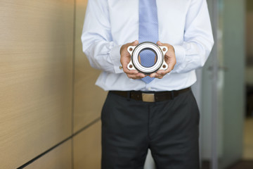 Businessman holding bearing part