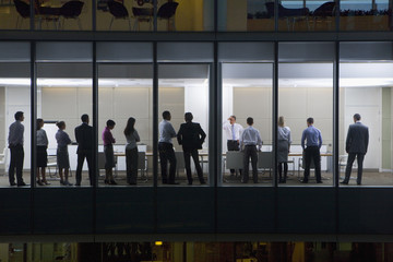 View of business people standing in conference room form outdoors