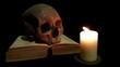 Human skull and book