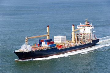 Cargo ship with containers moving